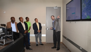 A delegation of engineers from the Electric Company of Ghana tour Bluebonnet's state-of-the-art control center.