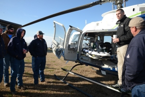 Billy Rice, a flight paramedic with PHI Air Medical, helps train Bluebonnet crews to work with the company's air ambulance.